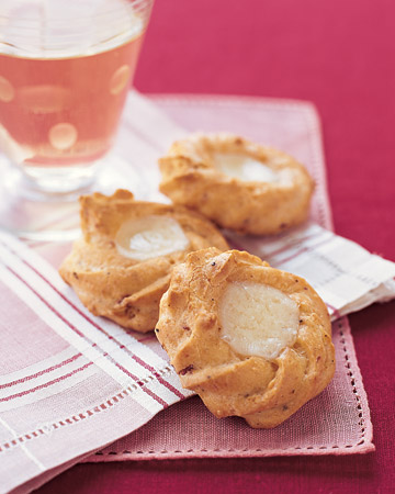 Ham and Gruyere Thumbprints: Based on a classic French recipe, these warm hors d'oeuvres are filled with Black Forest Ham and melted Gruyere.