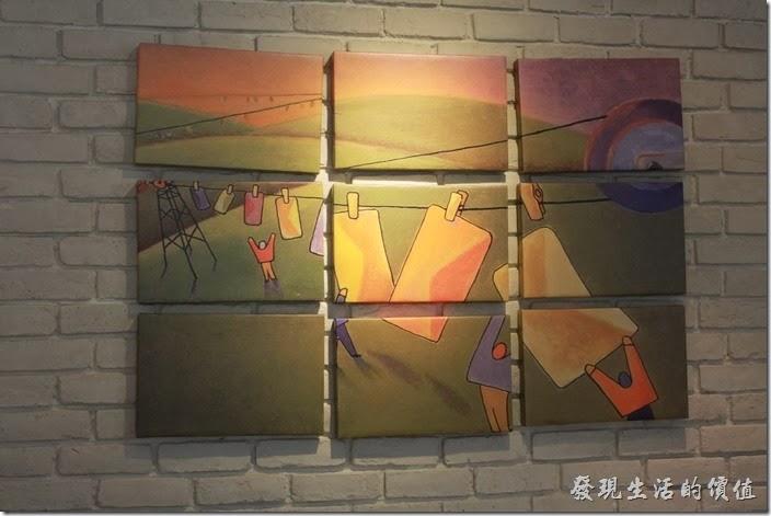 台南-小莫里。【Komori】餐廳的牆壁上拼圖畫。