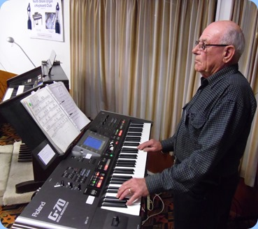Laurie Conder playing the arrival music on his Roland G-70 music workstation