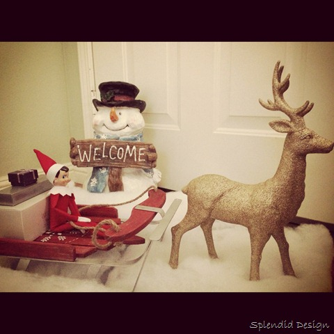 Elf on the Shelf riding on a sleigh