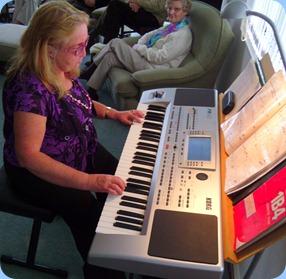 Desiree Barrows playing the Korg Pa80