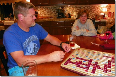 Regina Circeo and I watching  Tom and Ken play Scrabble.