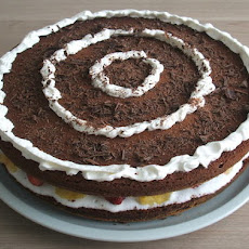 Chocolate Cake With Fruit And Whipped Cream