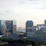 plane landing at haneda airport in Odaiba, Tokyo, Japan