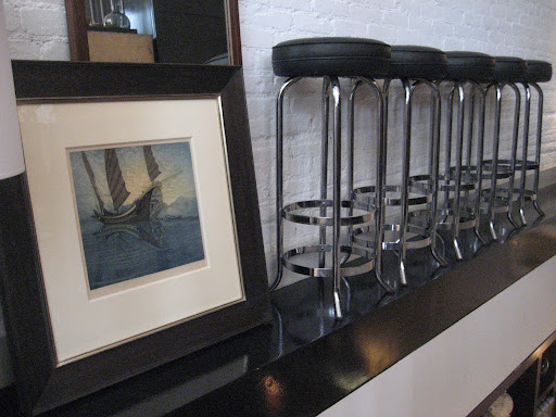 How crazy is this display of great, classic barstools and an old piece of art work.