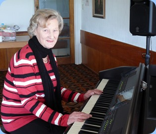 Eileen France playing the Clavinova. Photo courtesy of Dennis Lyons.