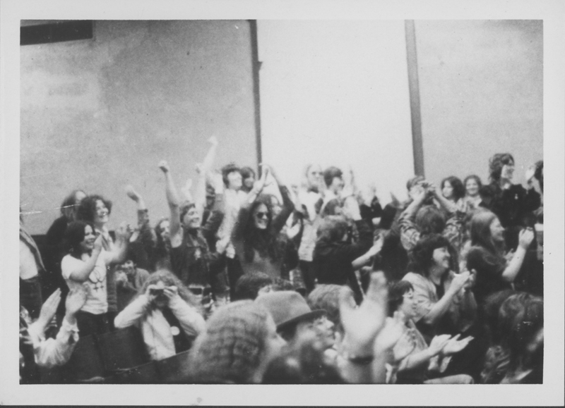 Women gather during registration at First National Lesbian Conference, Haines Hall, UCLA. 1,500 women filled th hall to listen to speeches, news, poets, and singers from 6pm to midnight. April 13, 1973.