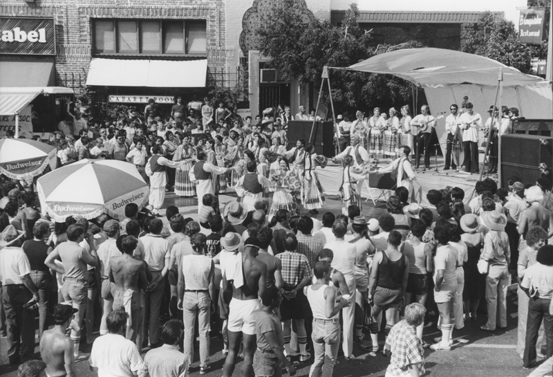 Crowd gathers around a music and dance performance at the Sunset Junction Street Fair. August 21-22, 1982.
