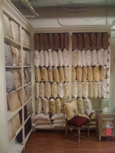 Here's a wall of pillows in the Silk Trading Company's signature silks. Let's take a look at the choices!