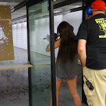 my sister shooting targets at the Niagara Gun Range in North Tonawanda, New York, United States