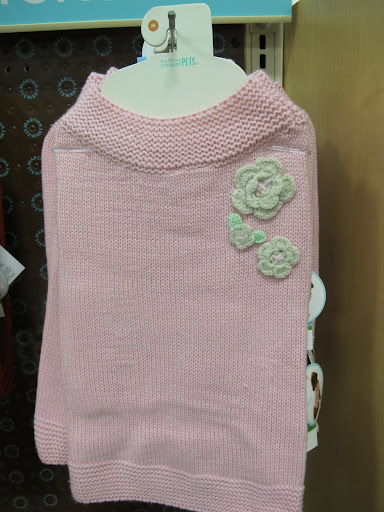 This fine knit sweater with crocheted flower adornments is so toasty.