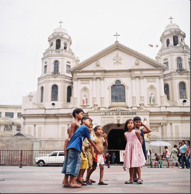 Street children play at the church facade in Quiapo, Manila on a slow day while their parents sell various goods and novelty items to tourists and churchgoers. They help out their parents during busy days.