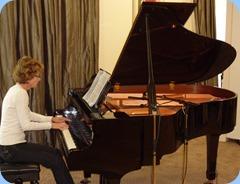Denise Gunson playing the Yamaha Grand Piano very professionally