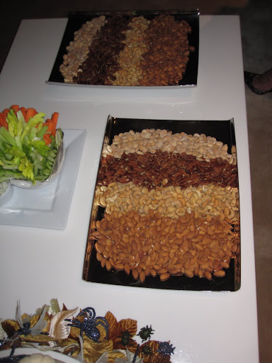 There is a pretty way to display different types of nuts -- on a platter all lined up.