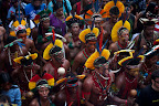 Indigenous marchers on Rios Flamengo Beach on June 19, 2012. Their bodies formed the lines of an enormous image promoting the importance of free-running rivers, truly clean energy sources like solar power and including indigenous knowledge as part of the solution to climate issues. The activity was led by Brazils many indigenous peoples organized under the umbrella of the Articulation of Brazilian Indigenous Peoples. Caroline Bennett