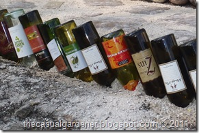 place wine bottles upside down in the sand