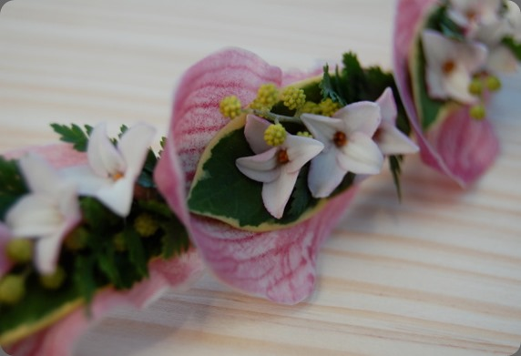 headbands sewn of cymbidium orchid petals, acacia, narcissus, rabbit foot fern, and daphne blossoms the monkey flower group 2