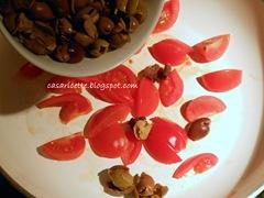 cdr radiatori con pomodorini e pesto di rucola, pomodori e olive taggiasche