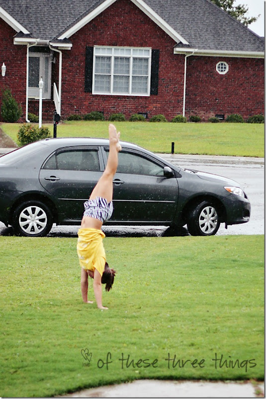 sam doing hand stand in hurricane blog