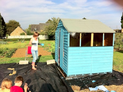 Frances paints shed allotment Wardington UK 2