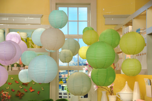 Inexpensive paper lanterns from Luna Bazaar (www.lunabazaar.com) come in a wide spectrum of colors and make a big impact when grouped en masse.