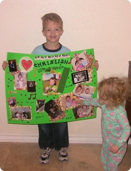 Christian with his sign and sister