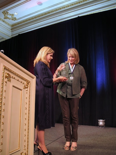In this photo Martha is receiving the National Humanitarian Medal for her advocacy of animal care and protection given by the American Humane Association's (AHA).