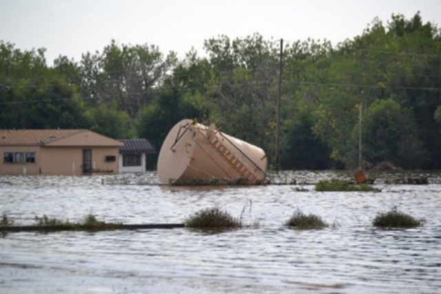 An oil tank is toppled after the massive flooding in Weld County, Colorado, in Evans, near 34th Street, 14 September 2013. Photo: Carl Erickson / Weld Air and Water