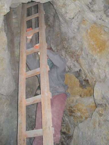 Descending a ladder through a small shaft.