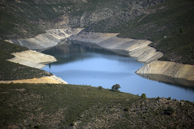 Aerial view of El Atazar reservoir, 16 March 2012. A lack of rain in Spain has caused the El Atazar reservoir to drop precipitously. El Atazar is the largest reservoir in Madrid and Spain is under severe drought conditions which have parched farmland with the driest winter in seven decades. Photo: hungeree.com