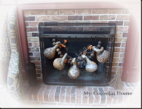 Gourds on firescreen