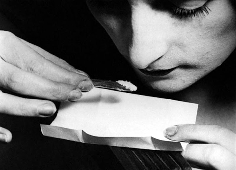 A woman consumes Cocaine (1920).jpg