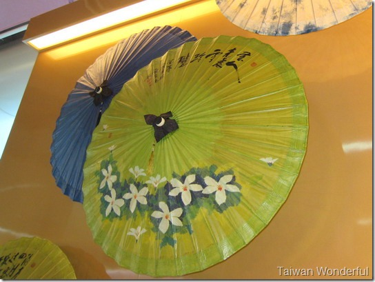 Paper umbrellas  are still made by hand in the Kakka enclave of Meinong, Kaohsiung County. The oil  used in the waterproofing process is extracted from the fruit of the tung tree.