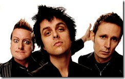 LOS ANGELES, CA - NOVEMBER 22:  (L-R) Musicians Tre Cool, Billie Joe Armstrong and Mike Dirnt of Green Day pose for a portrait at the 2009 American Music Awards at Nokia Theatre L.A. Live on November 22, 2009 in Los Angeles, California.  (Photo by Michael Caulfield/AMA2009/Getty Images for DCP)