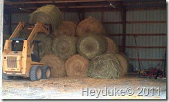 Stacking the round bales