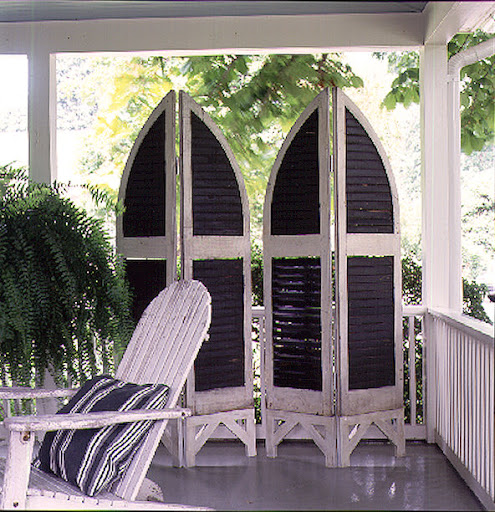 This clever screen made from antique shutters makes provides privacy and design interest on a porch. (Martha Stewart Living)