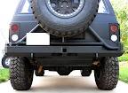 WarriorWelding rear tire carrier bumper holding a Raceline Monster with 35 inch Maxxis Trepador