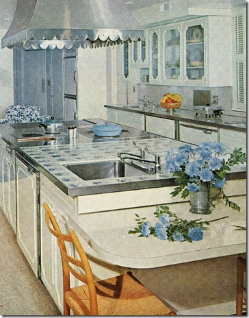The large kitchen, approximately, 15 x 37 feet, has a refreshing warmth and graciousness that is characteristic of the entire house. The island unit divides the room into work ceners, with sitting room at the far end. Featured in the Ocotber 1961 issue.