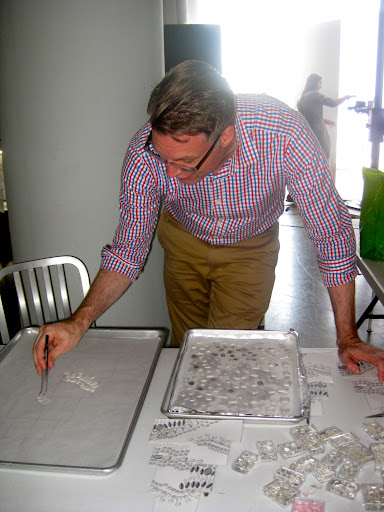 Design director, Michael McCormick, begins to map out the design of the necklace before it is applied to the cake.