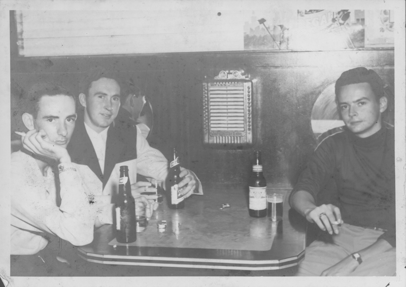 From left: Edgar Sandifer, Dirk and Bob? in a restaurant booth. Circa 1950s.