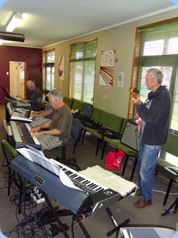 Jim Nicholson playing the Korg SP-250 digital piano with Brian Gunson adding guitar licks and Peter Brophy harmonizing in the background