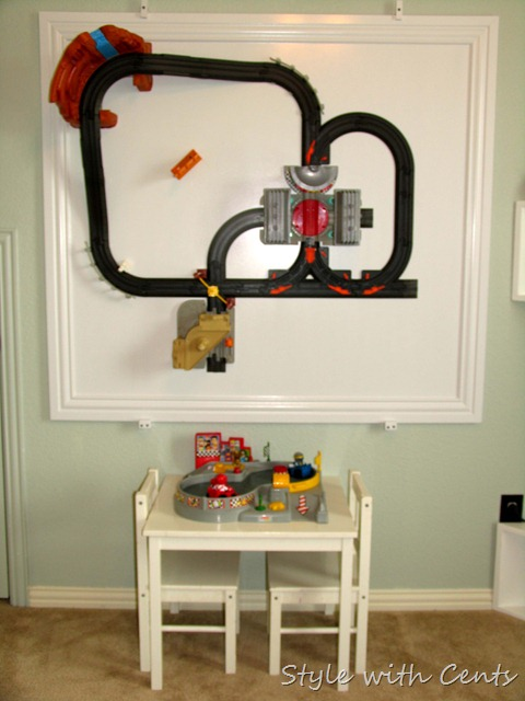 creating an inexpensive playroom4 hanging train tracks on walls playroom4