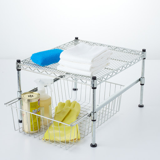 Wire racks make a great under-the-sink storage solution. You can keep all cleaning supplies in the drawer and rags and scrubbers piled neatly on top.