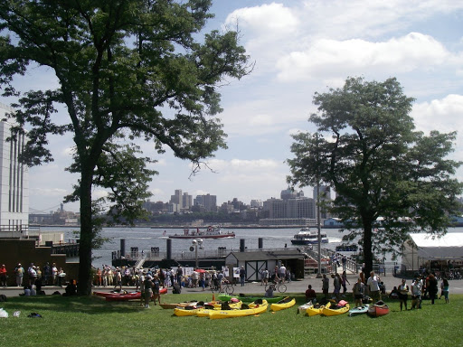 Kayaks on the grass (alas, alas) plus a nice red canoe (woohoo, woohoo) and out on the water, retired fireboat John J. Harvey & one of the New York Waterways ferries that were bringing people to & from the island all day.