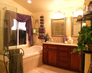 Pramik Master Bath - This romantic bathroom contains a new larger window. The shower, tub, vanity, mirror, lighting, flooring, and paint are new.