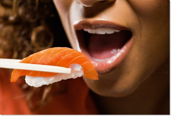 getty_rm_photo_of_woman_eating_salmon
