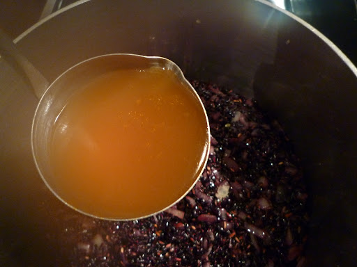 The wine has evaporated and now add the first ladleful of broth