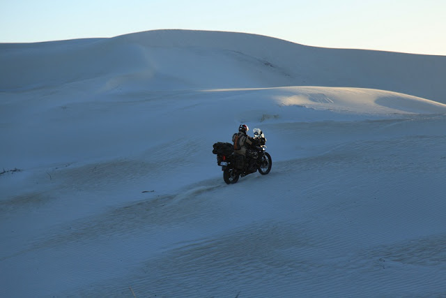 Riding with George into the dunes.JPG