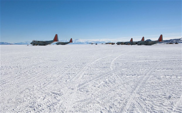 Airplanes on Airfield, Ross Ice Shelf, Antarctica. Researchers say that global warming has caused the glacial ice on the runway to turn to mush just four years after it was built for about £30 million. ALAMY