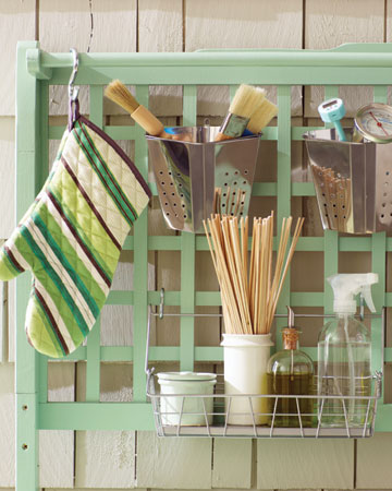 The lattice back of the grilling station offers plenty of space to organize all of your grilling utensils.